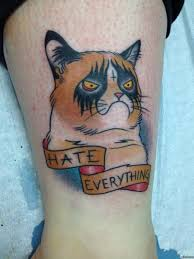 Грустный котик тату
